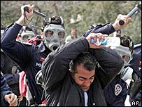 Turkish police beat protester