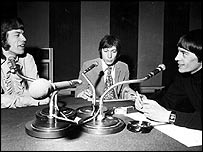 Tommy Vance (right) interviewing Mick Jagger and Charlie Watts