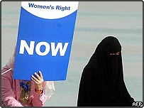 Women holding placards at demonstration in Kuwait City, Kuwait