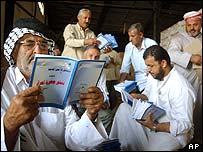 An Iraqi looks at a copy of the new constitution at a distribution centre in Najaf