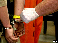 Handcuffed prisoner in US corrections facility (file)