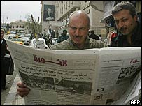 Syrians read al-Thawra newspaper in Damascus