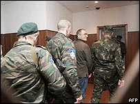 Mr Khodorkovsky, second on right, being escorted by prison guards