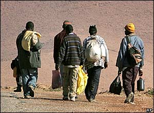 Illegal immigrants from Senegal walking on their way to Oujda, Morocco