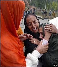 Sakina Mir, right, is hugged by a relative in Srinagar before returning to Pakistan-controlled Kashmir
