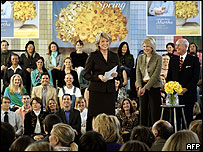 Martha Stewart surrounded by employees at her eponymous firm