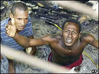 Inmates in the gutted prison in Higuey, the Dominican Republic