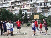 Welsh football fans playing football with orphans in Azerbaijan