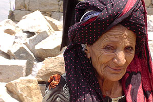 Yemeni woman with traditional colourful head dress