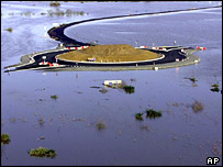 A roundabout emerges above flooded land in Brittany.  Image: AP/Franck Prevel