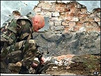 Isaf soldier checking the site of the rocket attack