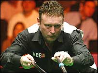 Jimmy White plays a shot with the rest