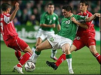 The Republic of Ireland's Robbie Keane battles for possession against Switzerland