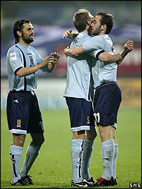 Scotland's three goalscorers celebrate in Slovenia