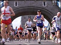 Athletes running over Tower Bridge