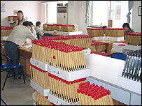 Workers in the Ri Feng lighter factory