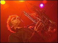 Tim Herman plays the saxophone in the band Los Albertos