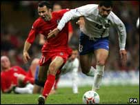 "Wales' Ryan Giggs and Azerbaijan""s Mohir Shukurov tussle for the ball during the World Cup qualifying match"