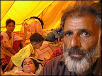 Nazimuddin Gillani with his family in tent, Muzaffarabad