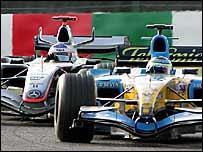 Giancarlo Fisichella's Renault leads from Kim Raikkonen's McLaren at Suzuka