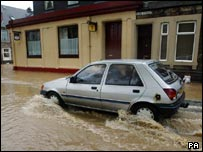 Car navigating floods