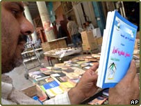 An Iraqi looks at a copy of the new constitution
