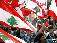 Lebanese demonstrators wave flags and banners at a pro-Syrian rally