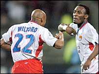 Goalscorers Sylvian Wiltord (left) and Michael Essien