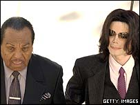 Michael Jackson at court with his father, Joe Jackson