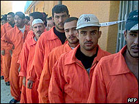 Iraqi prisoners wait to vote in the referendum