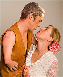 Photo of Mat Fraser towering over Anna Winslet in country and western gear