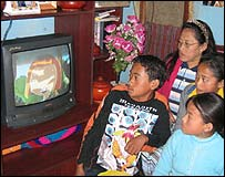 The Wangmo family is glued to TV in Bhutan