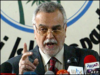 Tariq al-Hashimi, secretary general of Iraqi Islamic Party, gestures at a press conference in Baghdad