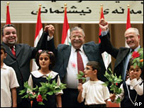 Parliamentary Speaker Hajim al-Hassani, President Jalal Talabani and Deputy Speaker Hussein al-Shahristani hold hands after making the amendments