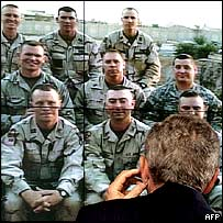 President Bush talks to his troops using a video link