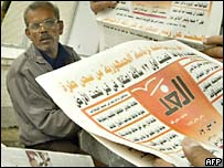 An Egyptian man reads the first edition of al-Ghad in Cairo
