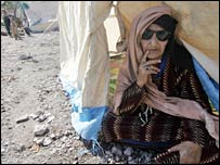 An elderly Kashmiri woman sits in a tent in Muzaffarabad, Pakistan