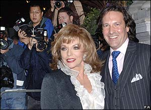 Joan Collins and her husband
