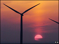 Wind turbine in Scotland against setting Sun.  Image: David Cheskin/PA