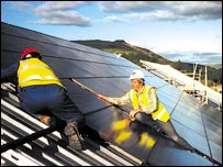 Solar panel installers on roof.  Image: Dulas ltd