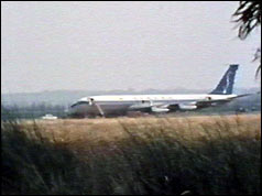 Plane on tarmac with steps and front door open