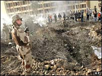 A US soldier at the scene of Wednesday's suicide car bomb attack in Baghdad