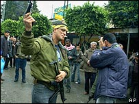 Palestinian militant fires gun in Tulkarm