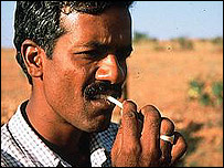 A man cleaning his teeth with a neem twig, BBC