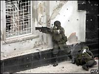 Russian forces storm a shop seized by rebels in Nalchik