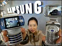 Lady demonstrates one of Samsung's phones
