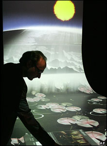 Man with display of virtual landscape