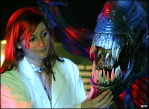 A woman and an alien model