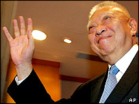 Hong Kong's Chief Executive Tung Chee-hwa waves as he leaves Hong Kong government headquarter Wednesday March. 9, 2005