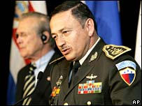 Guatemalan Minister of Defence Major General Carlos Humberto Aldana Villanueva (right) and US Defence Secretary Donald Rumsfeld in the background